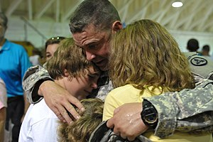 English: A 3rd ESC Soldier is welcomed by thei...