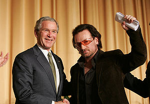 President George W. Bush shakes hands with Bon...