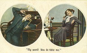 Man and woman using telephones, c. 1910 postcard