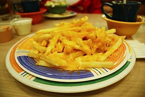 French fries covered in cheese