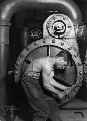 Lewis Hine Power house mechanic working on ste...