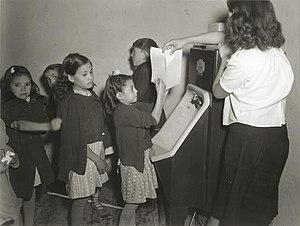 Children washing their hands before lunch. Tak...