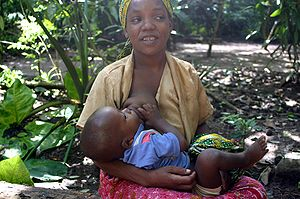 A mother breastfeeding a child at Zanzibar
