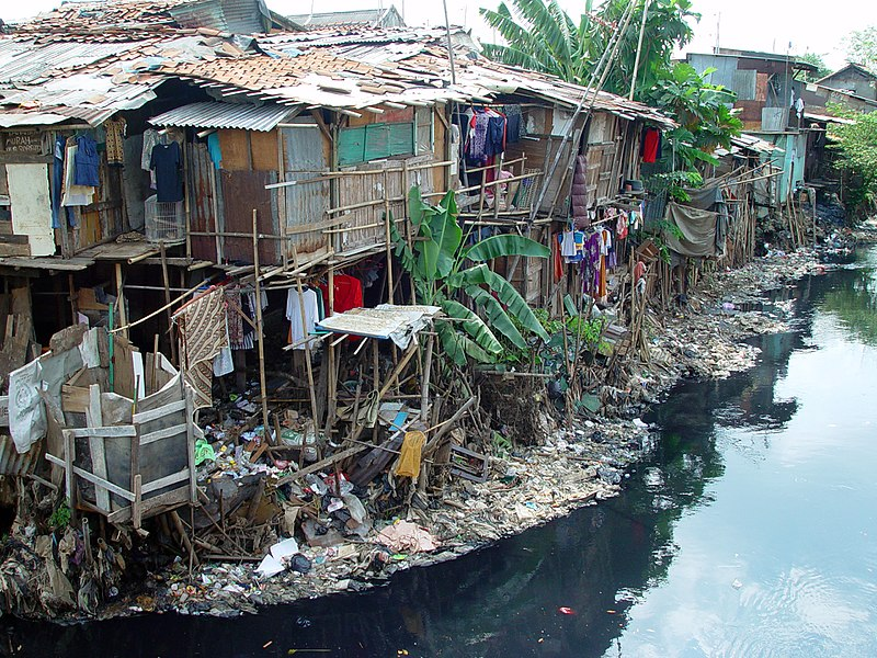 Slums built on swamp land near a garbage dump in East Cipinang, Jakarta Indonesia.