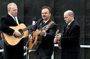 Singer and songwriter Jimmy Fortune, center, s...