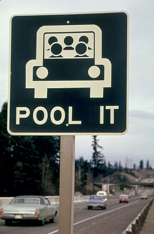 A sign encouraging carpooling during the gas s...