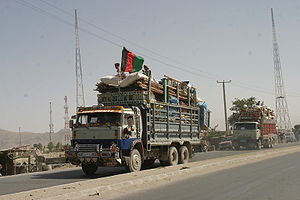 A truck loaded with Afghan refugees returning ...