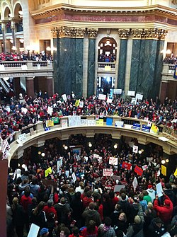 Overhead view of hundreds of people wearing red for the Teachers' union, protesting against Walker's bill.