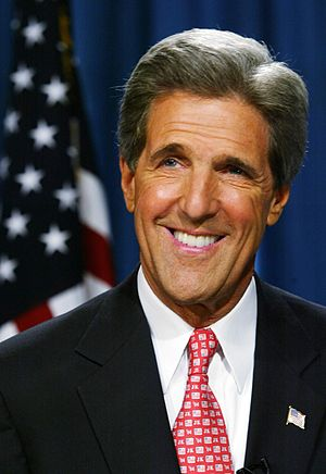 Headshot of John Kerry with the U.S. flag in t...