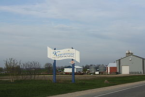 Looking east at the welcome sign for Kewaunee ...