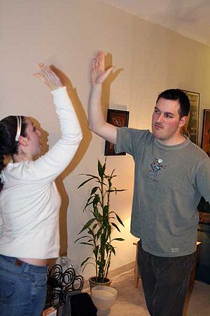 A woman and a man performing a high five.
