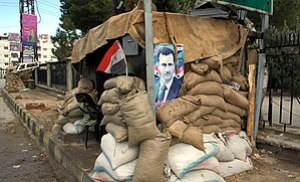 A poster of Bashar al-Assad at a checkpoint on the outskirts of Damascus