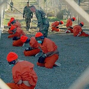 Detainees at Camp X-Ray Original caption: Deta...