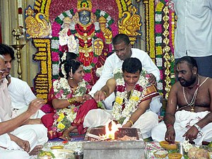 English: Hindu bride and groom by a holy fire ...