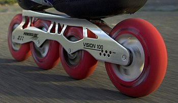 The wheels and frame of an inline skate.
