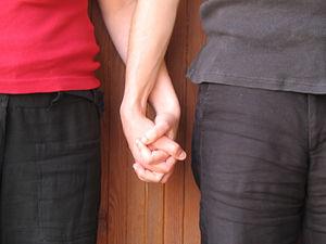 Holding hands symbolize registrated partnership.