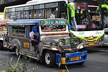 A jeepney and a bus, common forms of public transport in the Philippines.