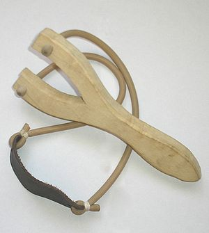 English: Wooden slingshot with rubber made in ...