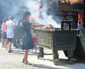 Burning incense in the Lama Temple Beijing