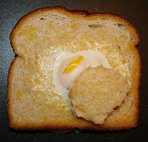 English: Egg in the basket: an egg cooking in ...
