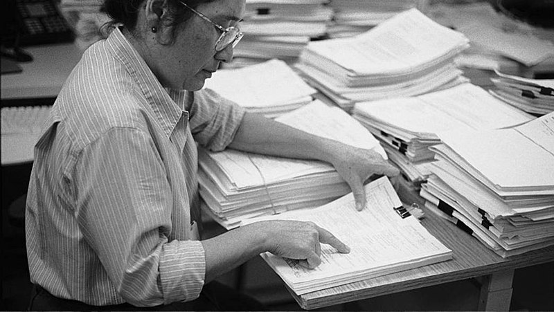 A reviewer at the National Institutes of Health evaluates a grant proposal. (Wikipedia)