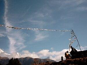 English: Sky and Buddhist prayer flags, waving...