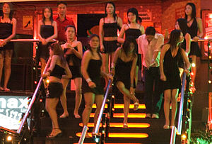 Prostitutes in front of a gogo bar in Pattaya,...