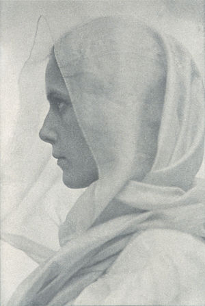 Profile portrait of woman draped with a veil. ...