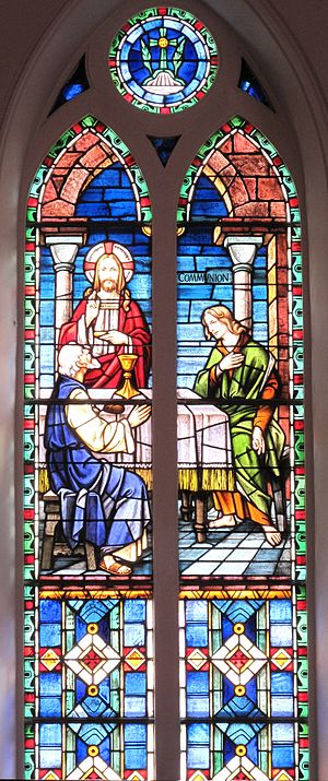 The Holy Communion stained glass window at St....