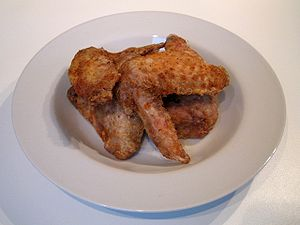 Home made fried chicken wings in a light flour...