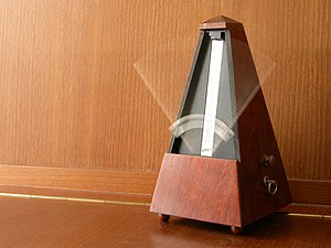 A mechanical wind-up metronome in motion