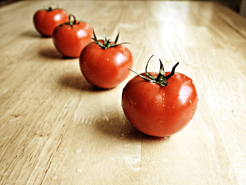File:Healthy Red Tomatoes are Wet and Organic.png