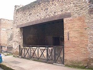 Exterior of a thermopolium in Pompeii, Italy.