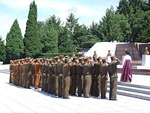 North Korean soldiers saluting at the Revolutionary Martyrs' Cemetery in Pyongyang, 2012