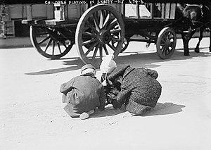 Children playing in street, New York