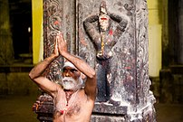A sadhu performing namaste in Madurai, India.
