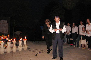 Holocaust survivor lights a torch in memory of...