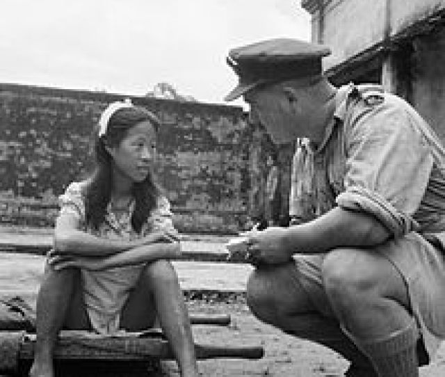 A Young Ethnic Chinese Woman From One Of The Imperial Japanese Armys Comfort Battalions Is Interviewed By An Allied Officer