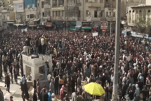 Large street demonstration, with speakers addressing the crowd