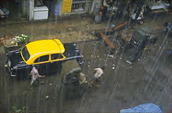A view of rain falling on a street of Kolkata, India.