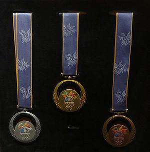 A set of 1998 Winter Olympics medals on displa...