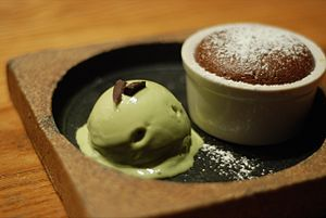 Flourless chocolate cake with green tea ice cr...
