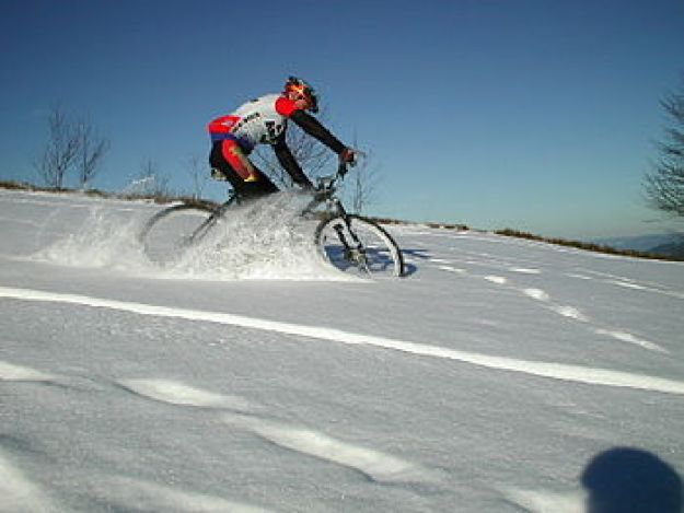 man winter biking in the snow