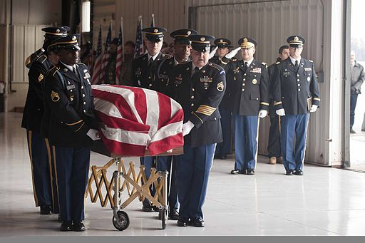 A U.S. Army honor guard carries the casket of Spc. Robert Tauteris Jr 120115-A-MG787-044