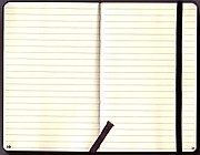 Inside view of a Moleskine ruled notebook; the elastic band is visible on the right, as is the bookmark in the center.