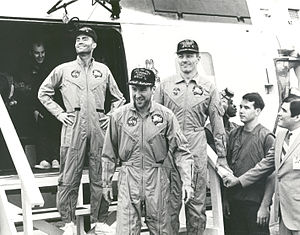 The crew of the Apollo 13 mission step aboard ...