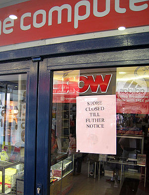 Notice of closure attached to the door of a co...
