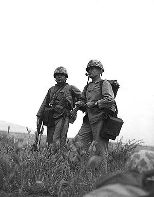 Marine Colonel Lewis B. Puller, right, who dis...