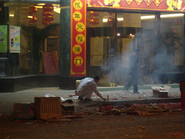 A Chinese man setting off fireworks during Chinese New Year in Shanghai. (6 February 2008)