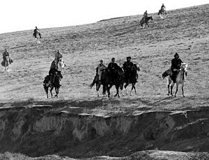 U.S. special forces troops ride horseback as t...